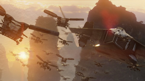 swarm of helicopters flying at sunrise