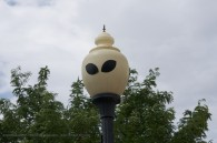 lamp post with alien eyes