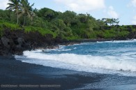 black sand beach and ocean waves