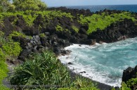 black sand in tropical island cove