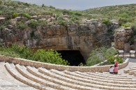 outdoor amphitheater overlooking cave entrance