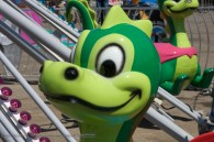 cartoon like dragon head on an amusement park ride