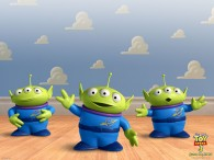 a group of little green men alien toys from toy story