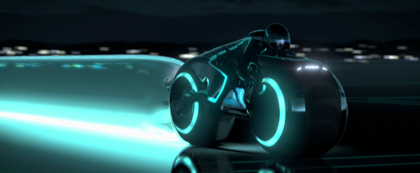 a light cycle speeds past from the world of tron legacy
