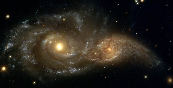 hubble telescope image of two massive galaxies colliding in space