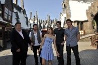 actors from the Harry Potter movies pose in Hogsmeade