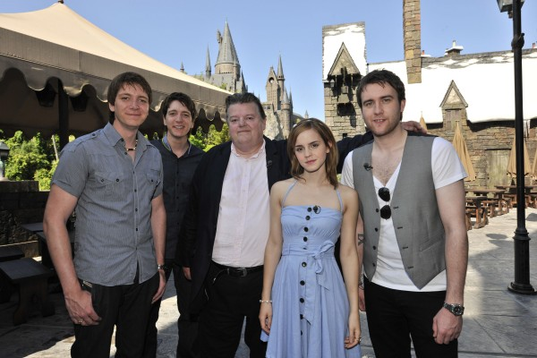Cast from the Harry Potter movies pose in Hogsmeade village