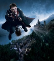 Harry Potter flys his broomstick over Hogsmeade Village and Hogwarts