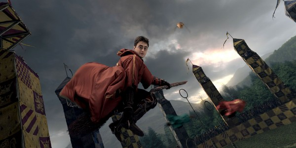 Harry Potter flying on a broomstick in a quidditch game