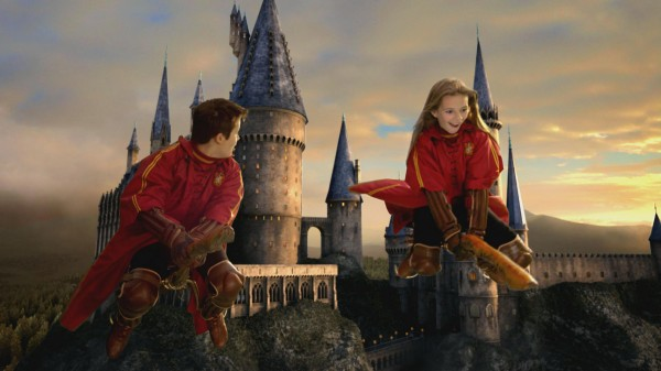 two young wizards flying on broomsticks