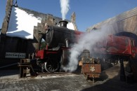 steam locomotive pulling in to the town of Hogsmeade
