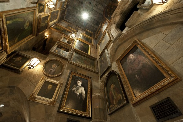 high hall filled with large portraits that can move