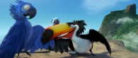 Rafael the toucan talks to Blu the macaw while Jewel looks on in a scene from the movie Rio