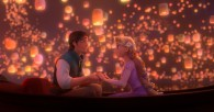 Flynn and Rapunzel in a boat with lanterns overhead from Disney's animated movie Tangled