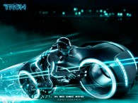 Sam Flynn riding the blue light cycle from Disney's Tron Legacy movie wallpaper