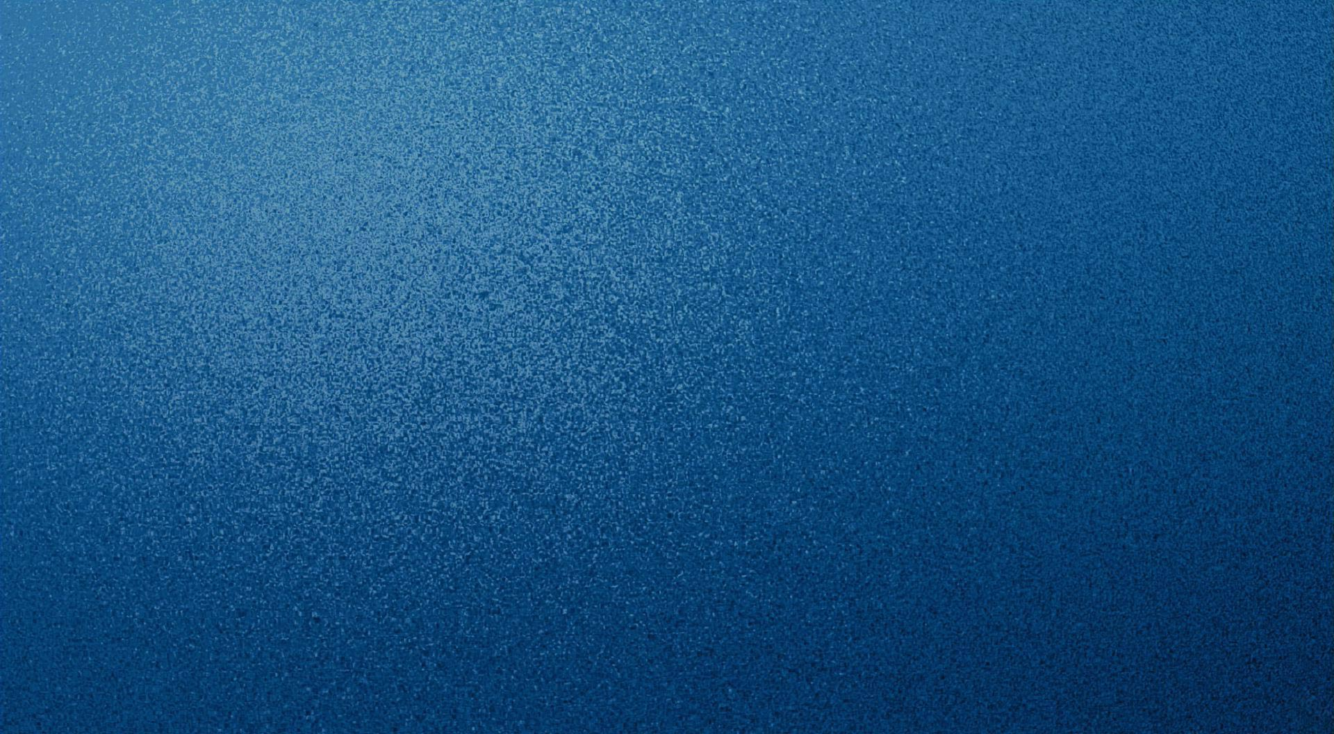 Blue textured speckled desktop background wallpaper for use with mac