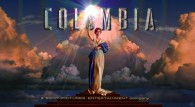 The Columbia Pictures Movie Studio logo featuring a woman holding a torch against a cloudy sky wallpaper