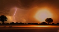 lightning strikes and flashes over the African savanna wallpaper