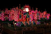 It's a Small World attraction at Disneyland at night decorated for Christmas wallpaper
