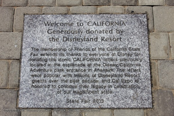 Entrance plaza for the California State Fairgrounds showing dedication plaque from Disney's California Adventure
